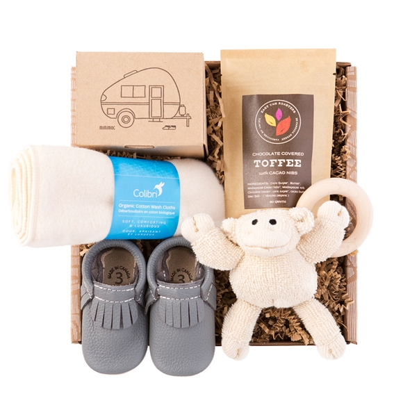 Cute baby shoes and chocolate for mom
